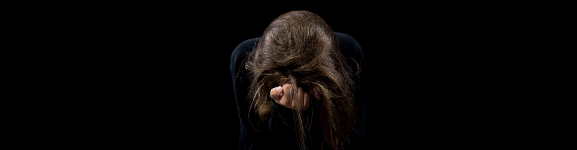 adult woman crying looking down